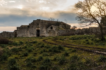 an ancient and abandoned rural house in Italy photo
