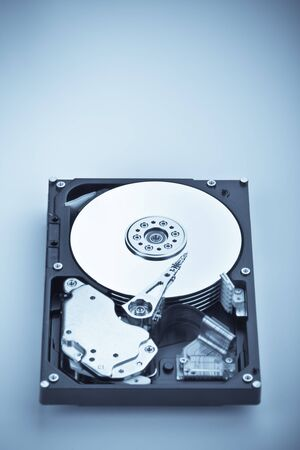an opened hard disk on white background photo