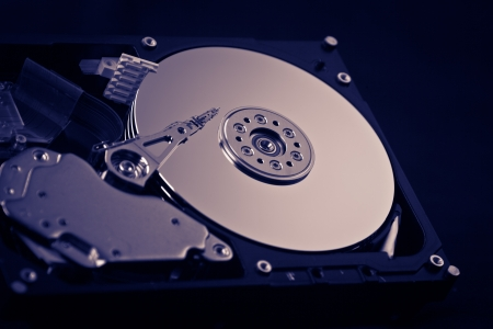 an opened hard disk on black background photo