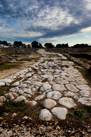 gravel roads: an ancient path in an archeological site in Italy Stock Photo