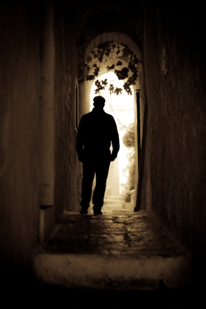 An Italian guy walking alone in a little italian village Stock Photo