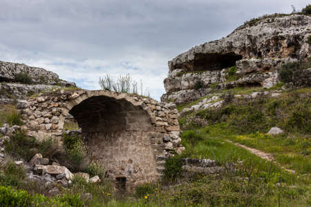 rupestrian: landscape of a gorge (in italy these formations are known as gravina) with caves and slopes Stock Photo