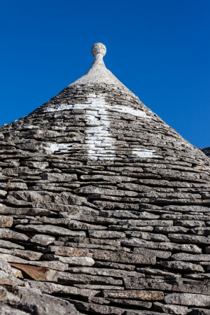 Ancient residential structures known as Trulli, found in Alberobello, in the south of italy photo