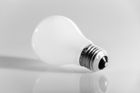 macro shot of an obsolete incandescence light bulb over a white background photo