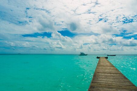 Tropical Pier with two boat photo