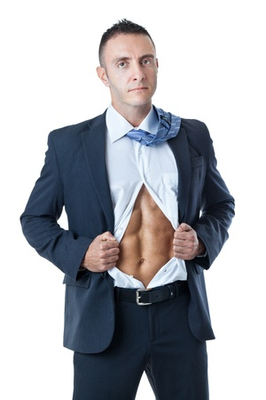 an handsome businessman showing his abs under the shirt Stock Photo