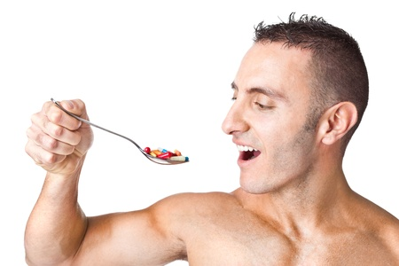 an handsome man taking a spoon full of pills