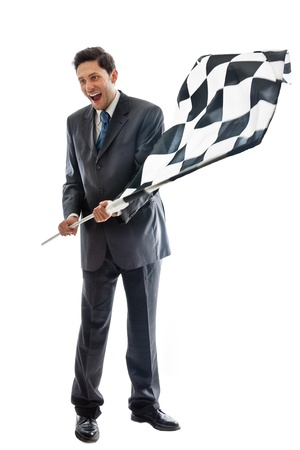 A Young Businessman isolated on a white background waving a checkered flag photo