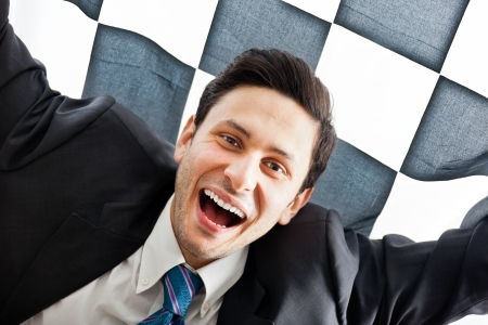 A Young Businessman on a checkered background photo
