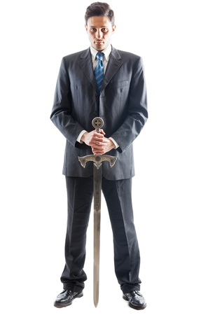 A Young Businessman isolated on a white background holding a steel sword
