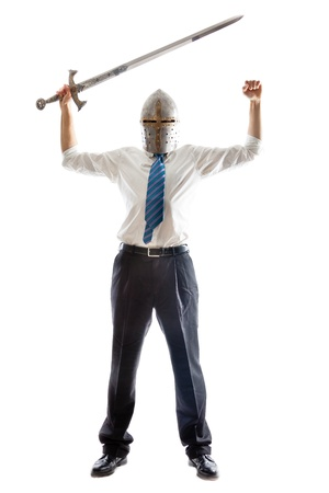 A Young Businessman isolated on a white background holding a steel sword and wearing an helm Stock Photo