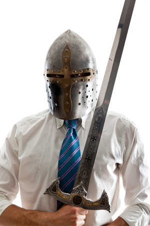 A Young Businessman isolated on a white background holding a steel sword and wearing an helm Stockfoto