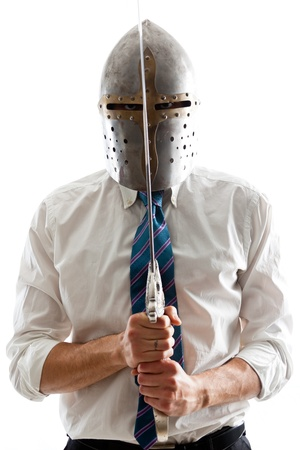slayer: A Young Businessman isolated on a white background holding a steel sword and wearing an helm Stock Photo
