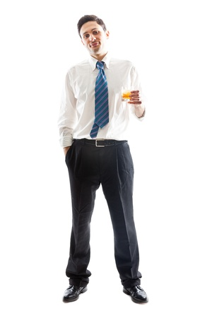 tipsy: A young Businessman isolated on a white background with a glass of whiskey