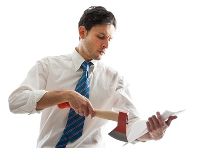 deranged: a young Businessman with hatchet looking at some documents Stock Photo
