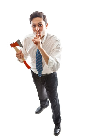 deranged: a young Businessman with hatchet standing