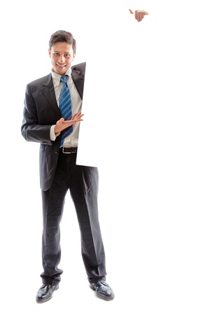 A young businessman holding a white billboard Stock Photo