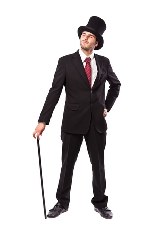 Businessman with Yop Hat and walking stick in a suite  photo