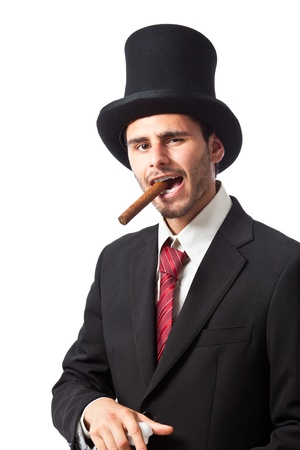 a rich businessman with a cigar wearing a top hat and carryng a walking stick  photo