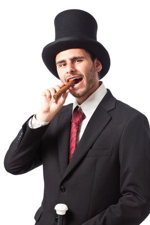 a rich businessman With a cigar wearing a top hat and carryng a walking stick Stock Photo - 20330565