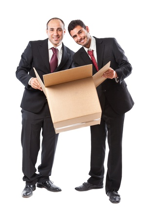 Two Businessman standing on a White background and looking inside a box Stock Photo - 20330564