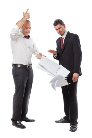 a businessman throwing paperwork an quitting the job in front of his boss