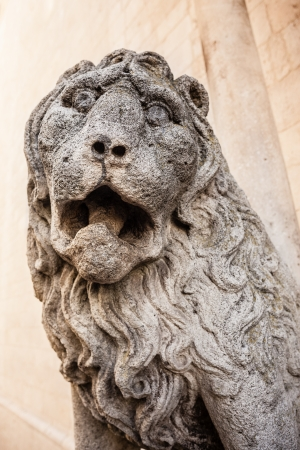 ancient sculpture of a fierce lion roaring over a stone wall Stock Photo - 20386675