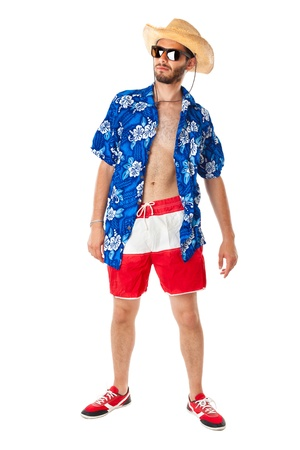 boardshorts: a young, attractive male in a colorful outfit ready to travel as a stereotype tourist Stock Photo