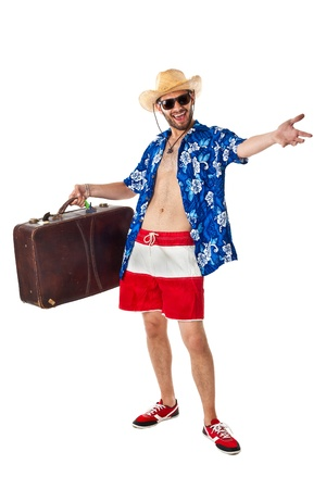 a young, attractive male in a colorful outfit ready to travel as a stereotype tourist photo