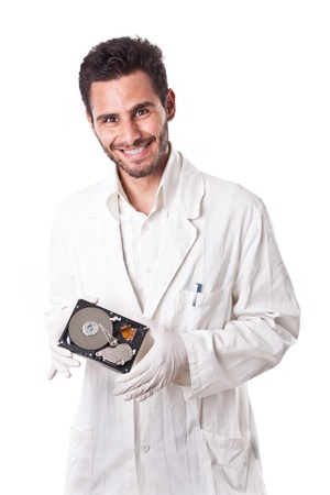 a technician wearing lab coat holding an hard disk drive photo