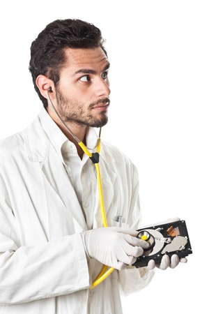 a DoctorTechnician wearing a lab coat and stethoscope holding an hard disk photo