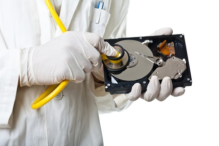 a DoctorTechnician wearing a lab coat and stethoscope holding an hard disk