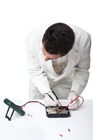 A technician repairing an hard disk with a tester