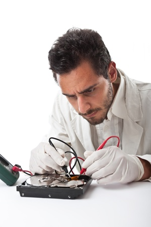 A technician repairing an hard disk with a tester photo