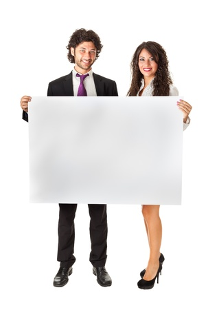 An elegant business couple holding a blank whiteboard and promoting something photo