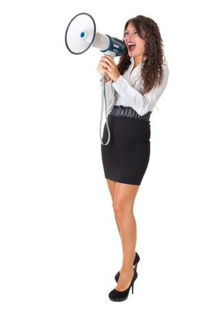 Beautiful businesswoman with a megaphone over a white background photo