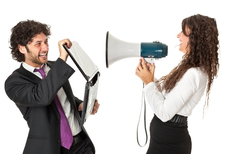agitated: A gorgeous businesswoman yelling at a businessman with a megaphone