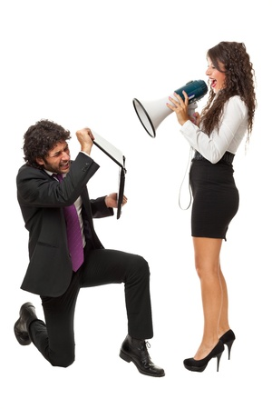 A gorgeous businesswoman yelling at a businessman with a megaphone
