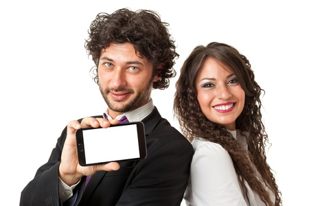 Bright shot of a gourgeous business couple holding a smartphone with blank screen over a white background photo