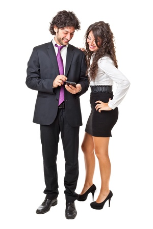 Bright shot of a gourgeous business couple using a smartphone over a white background Stock Photo