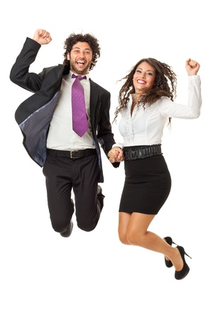 elated: An handsome businessman and a gorgeous businesswoman jumping over a white background Stock Photo