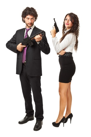 A businessman and a businesswoman (or maybe a couple of spies or gangster) holding guns over a white background Stock Photo - 20422313