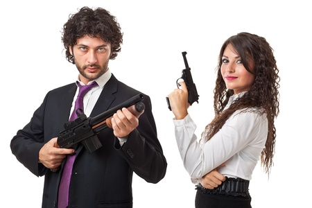 A businessman and a businesswoman (or maybe a couple of spies or gangster) holding guns over a white background Stock Photo