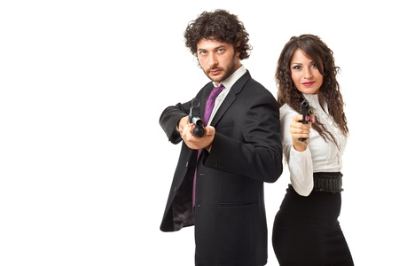 A businessman and a businesswoman (or maybe a couple of spies or gangster) holding guns over a white background photo