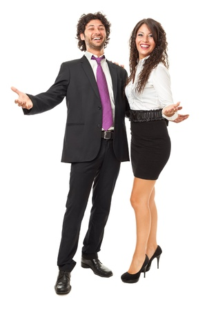 handsome businessman and gorgeous business woman with open arms over a white background photo