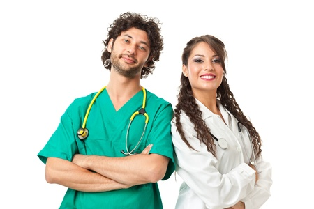 A beautiful young doctor and an hand some nurse with sthetoscopes over white background photo