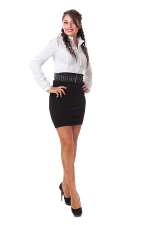 a Beautiful business woman posing over a white background photo