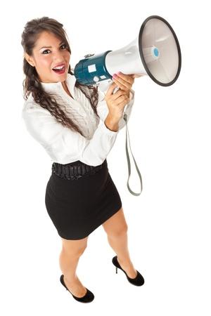 Una hermosa mujer de negocios con un megáfono sobre un fondo blanco Foto de archivo