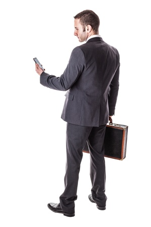 people from behind: a well dressed businessman standing over a white background with a suitcase