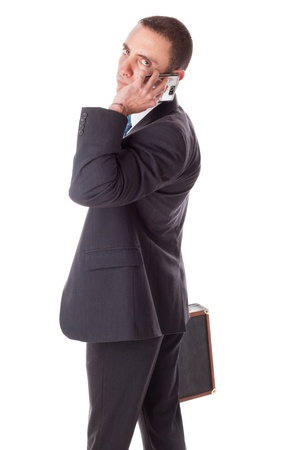 a well dressed businessman standing over a white background with a suitcase photo